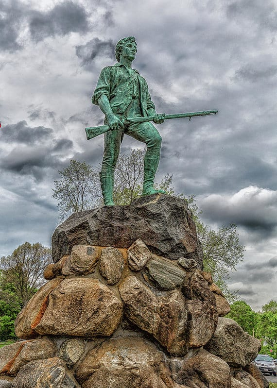 The minuteman statue in Lexington, MA on a cloudy day.
